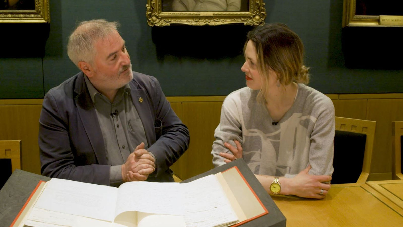 Chris Riddell and Molly Flatt sit at a table in the British Library in discussion