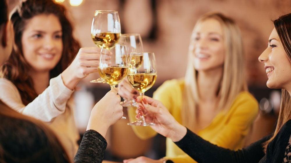 Women drinking white wine
