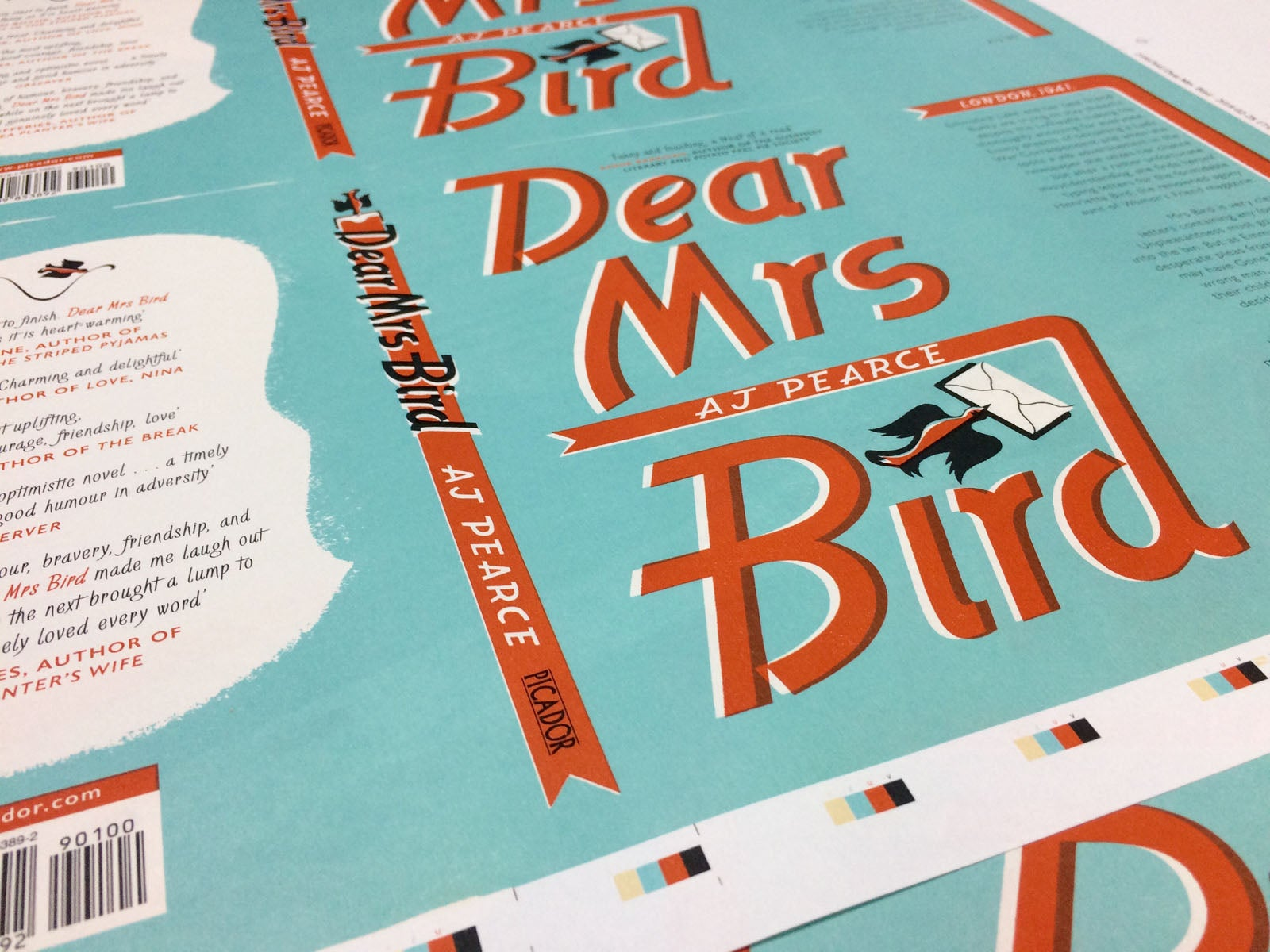 A close-up shot of the finished printed jackets of Dear Mrs Bird.