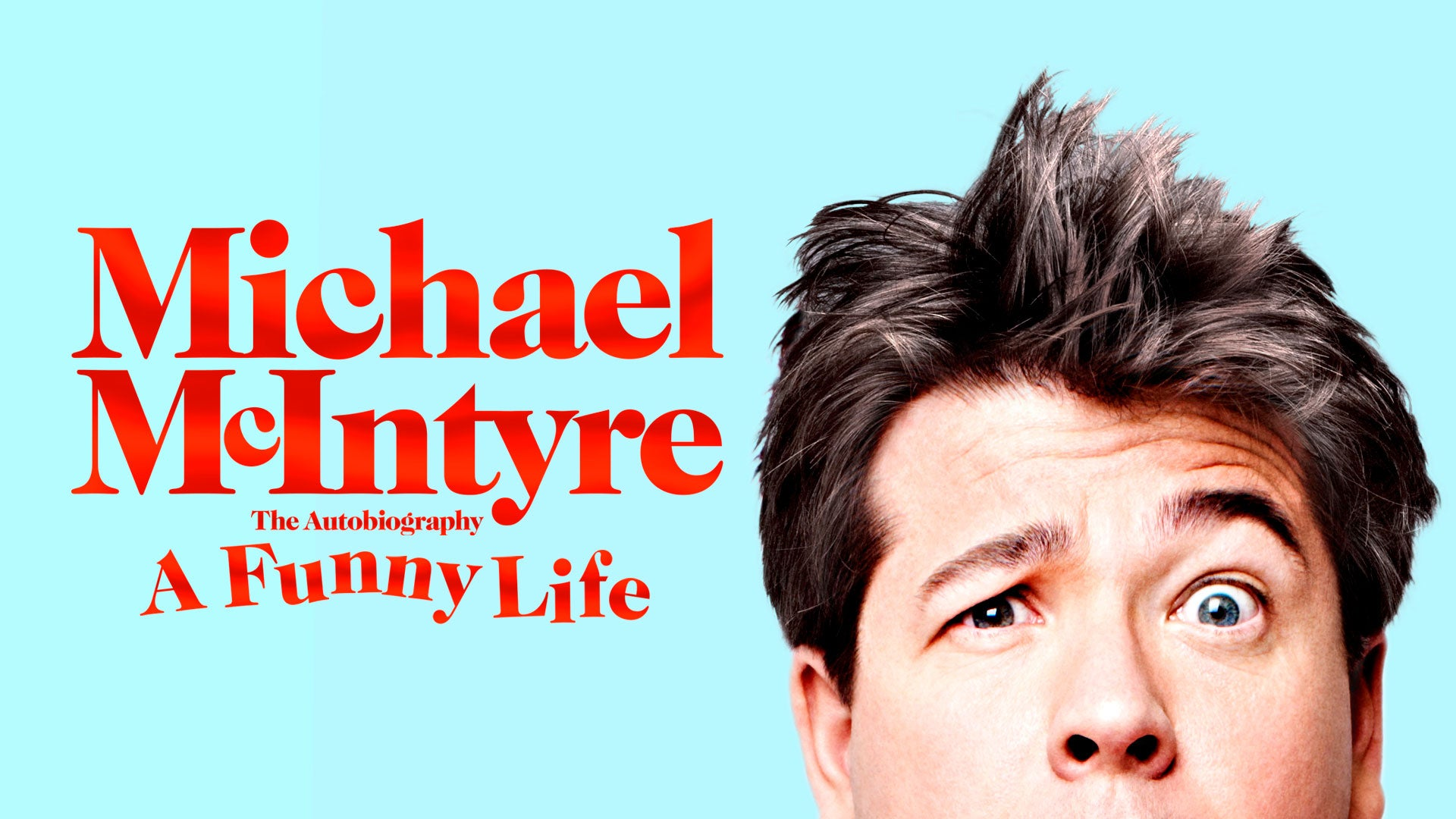 Half of Michael McIntyre's confused face can be seen on a blue background, next to the words 'Michael McIntyre The Autobiography A Funny Life'