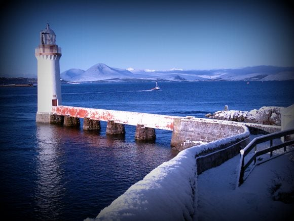 Eilean Bàn Lighthouse with the Cuillins beyond in snow