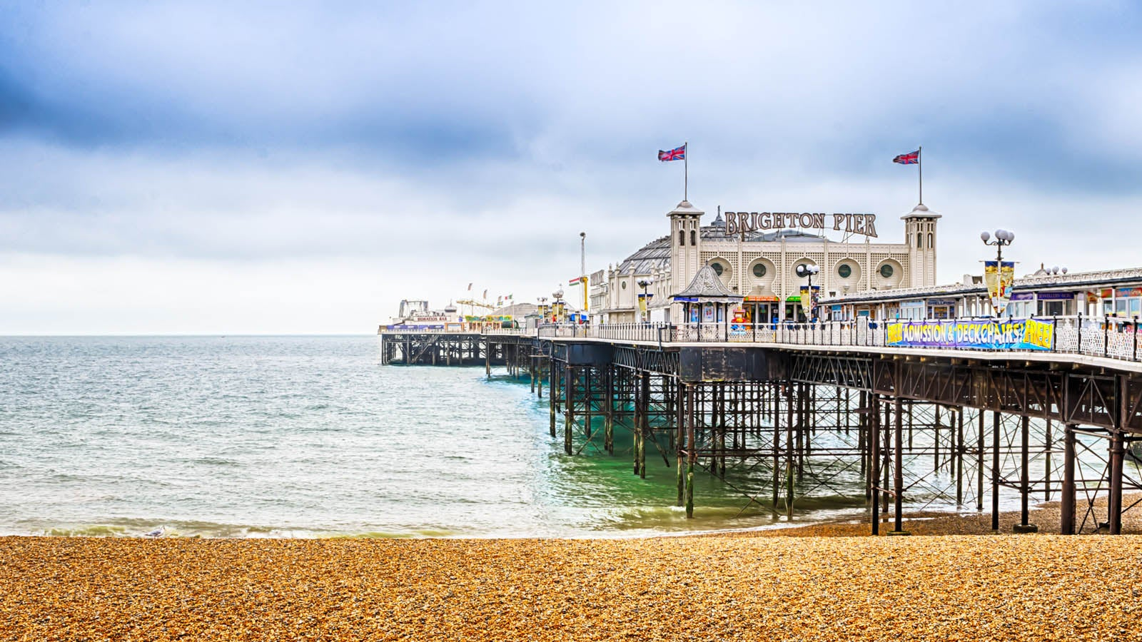 A photograph of Brighton Pier taken from the beach.