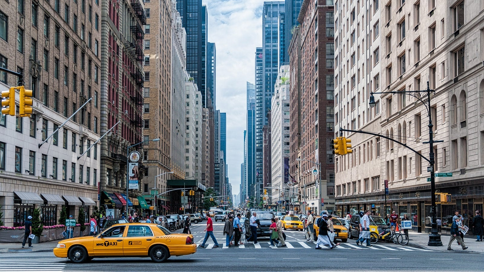 New York City intersection with yellow taxi
