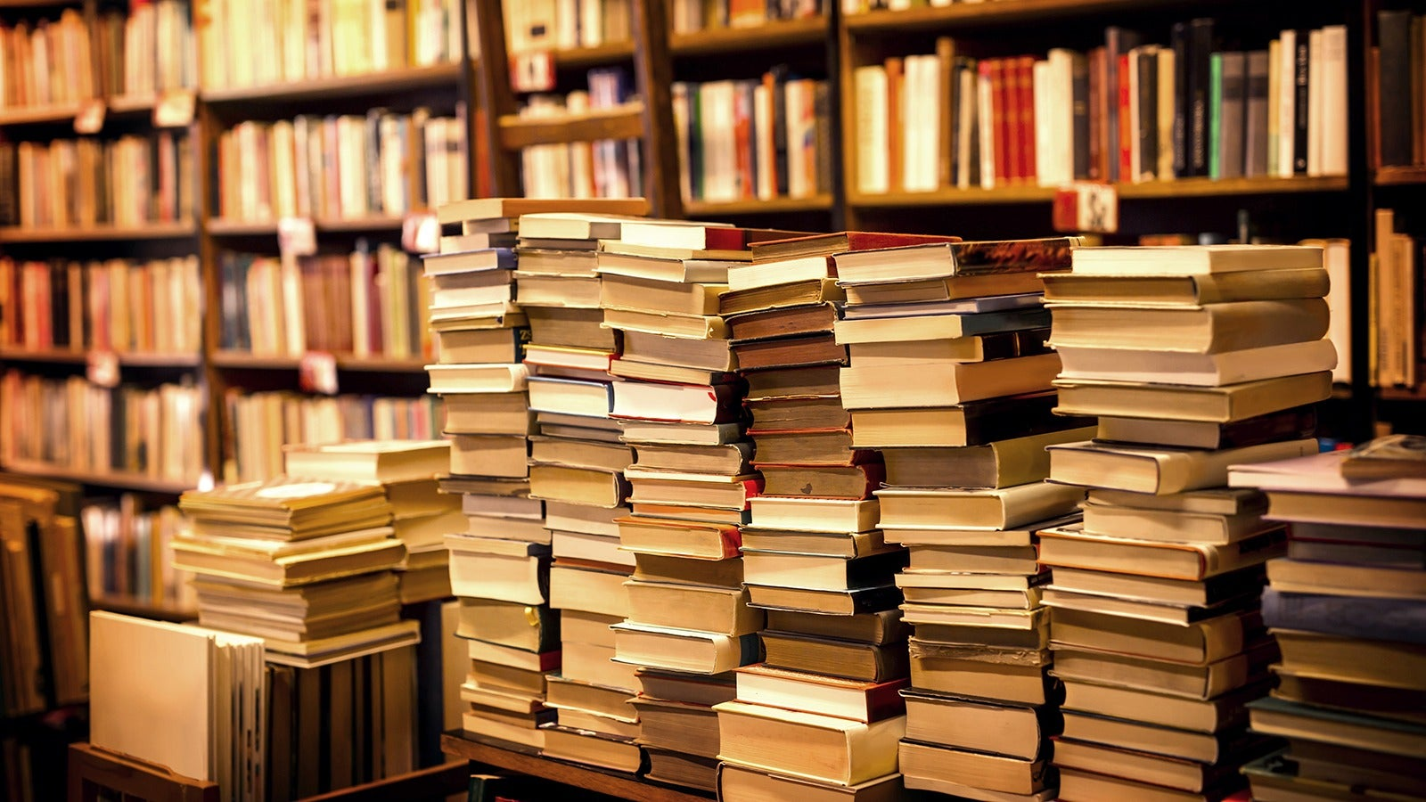 Books on shelves and piles of books
