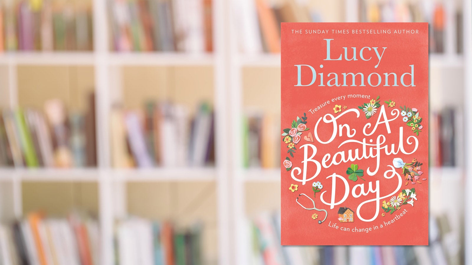 Lucy Diamond's On A Beautiful Day against a backdrop of a bookshelf.