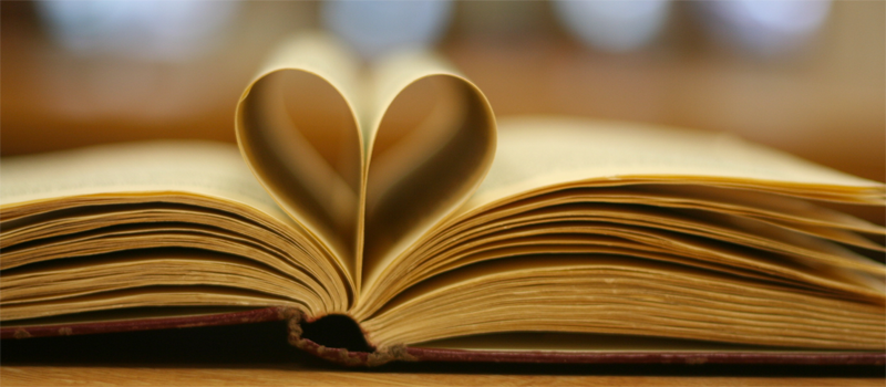 Hardback book open with two pages bent to look like a heart in the middle