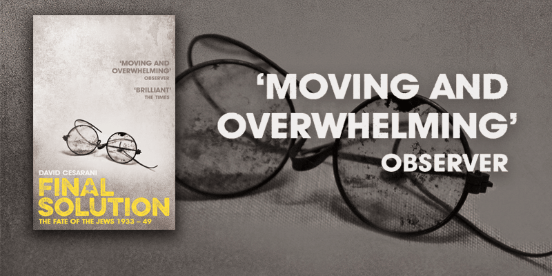 David cesarani's book Final Solution about the Holocaust with a pair of crushed spectacles