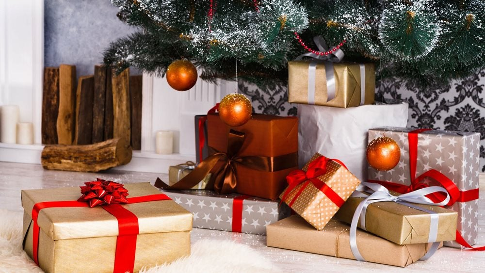 Christmas gifts around the bottom of a tree