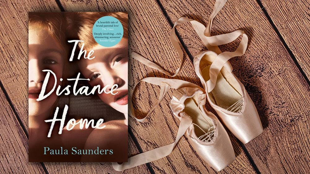 Book cover of The Distance Home next to a pair of ballet shows on a wooden floor