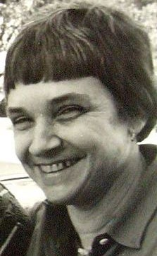 black and white photograph of Adrienne Rich smiling