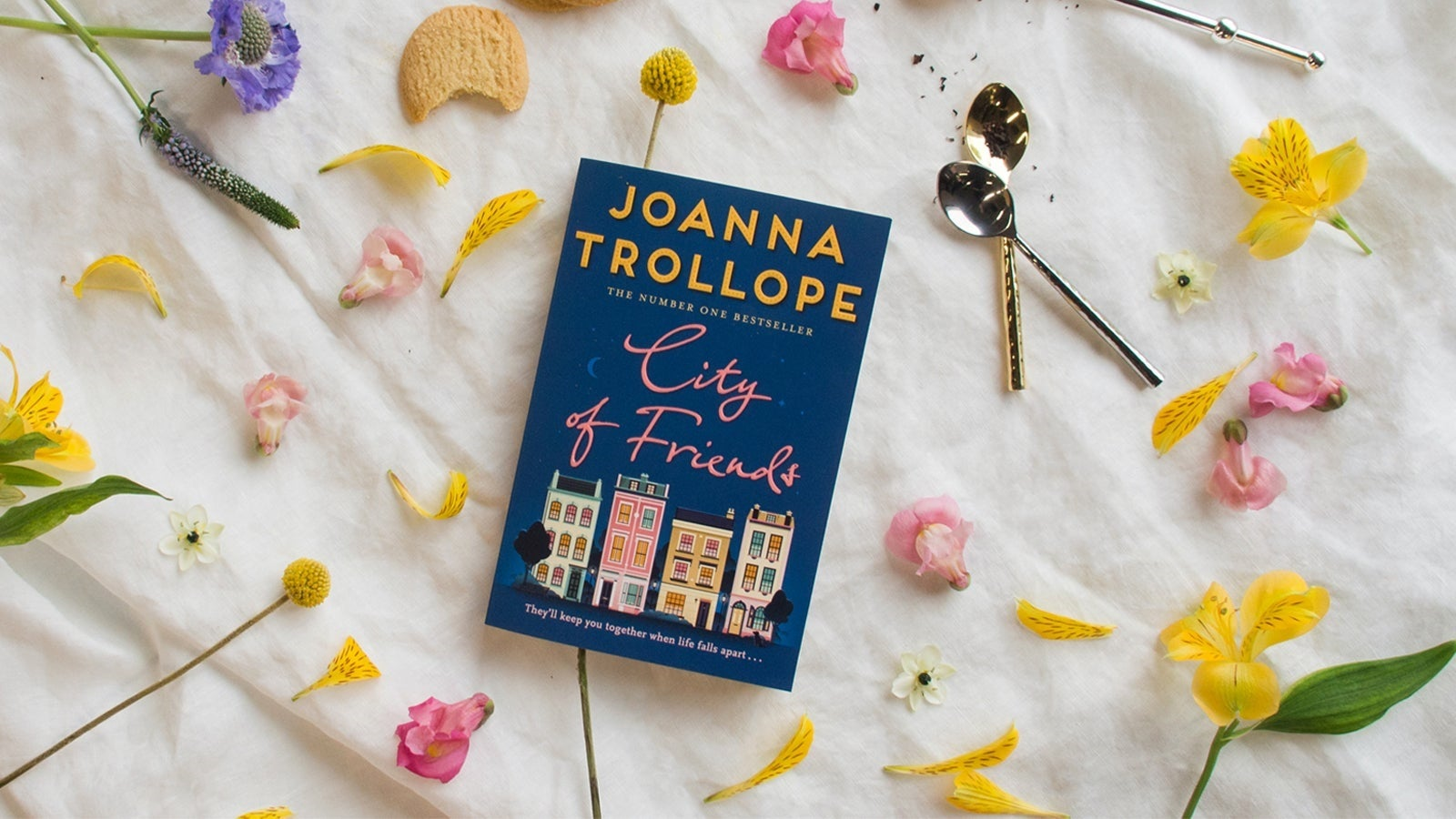City of Friends book pictured surrounded by flowers