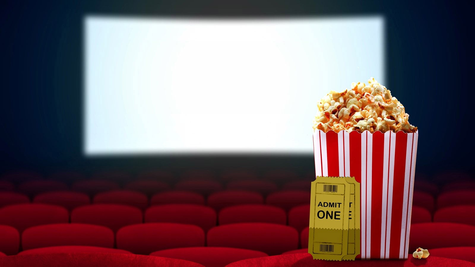 Empty cinema with white screen, popcorn and tickets