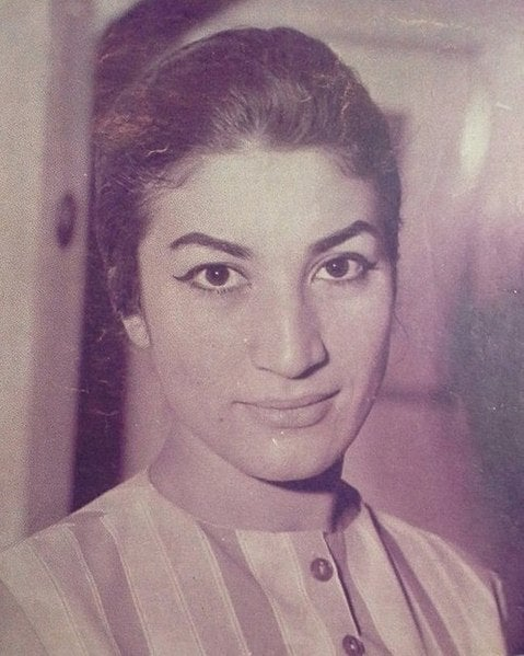Black and white photograph of Forough Farrokhzad smiling