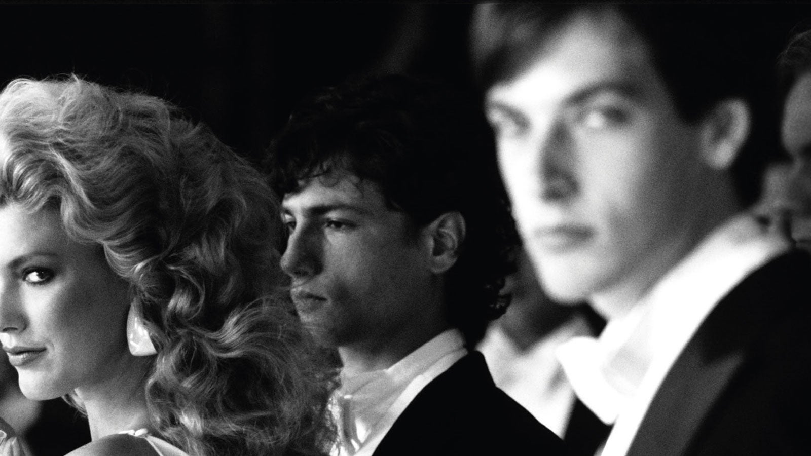 A woman and two men in black tie. A photograph taken from the cover of Alan Hollinghurst's The Line of Beauty