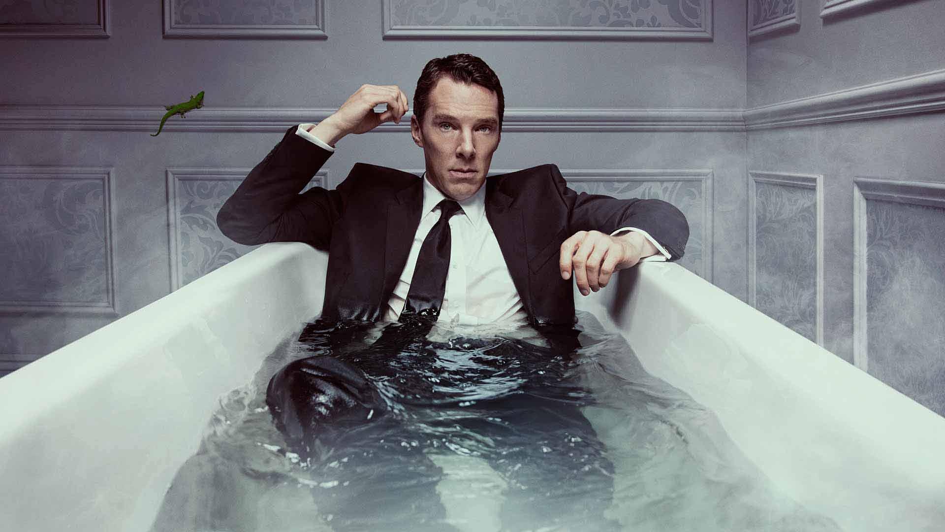 Benedict Cumberbatch as Patrick Melrose in a suit in a bath