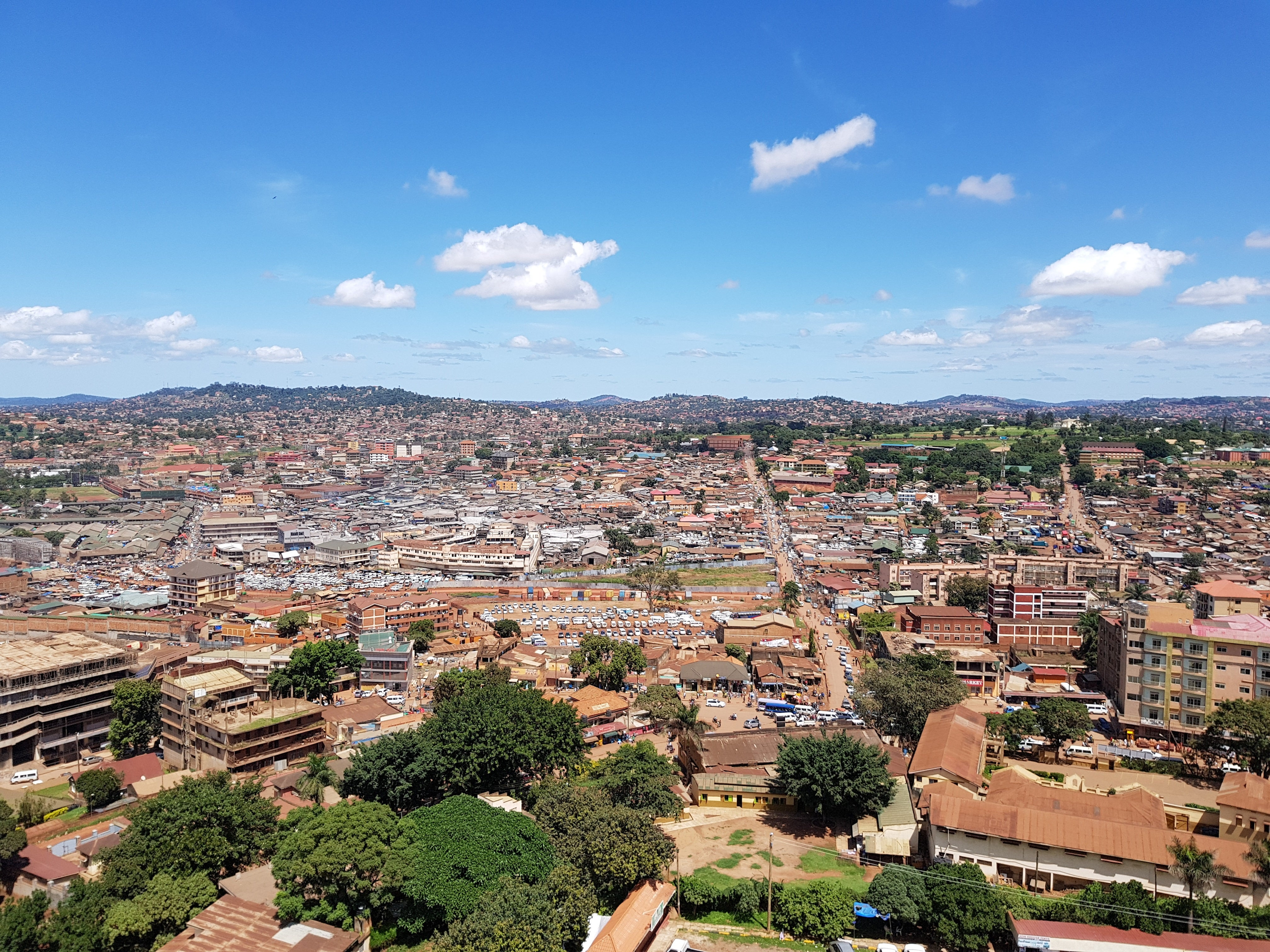 Kampala city centre seen from above, with the hills in the distance