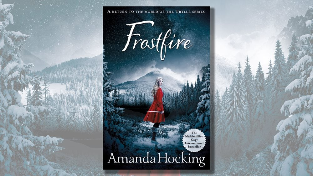 Frostfire book cover with a snowing alpine forest in the background