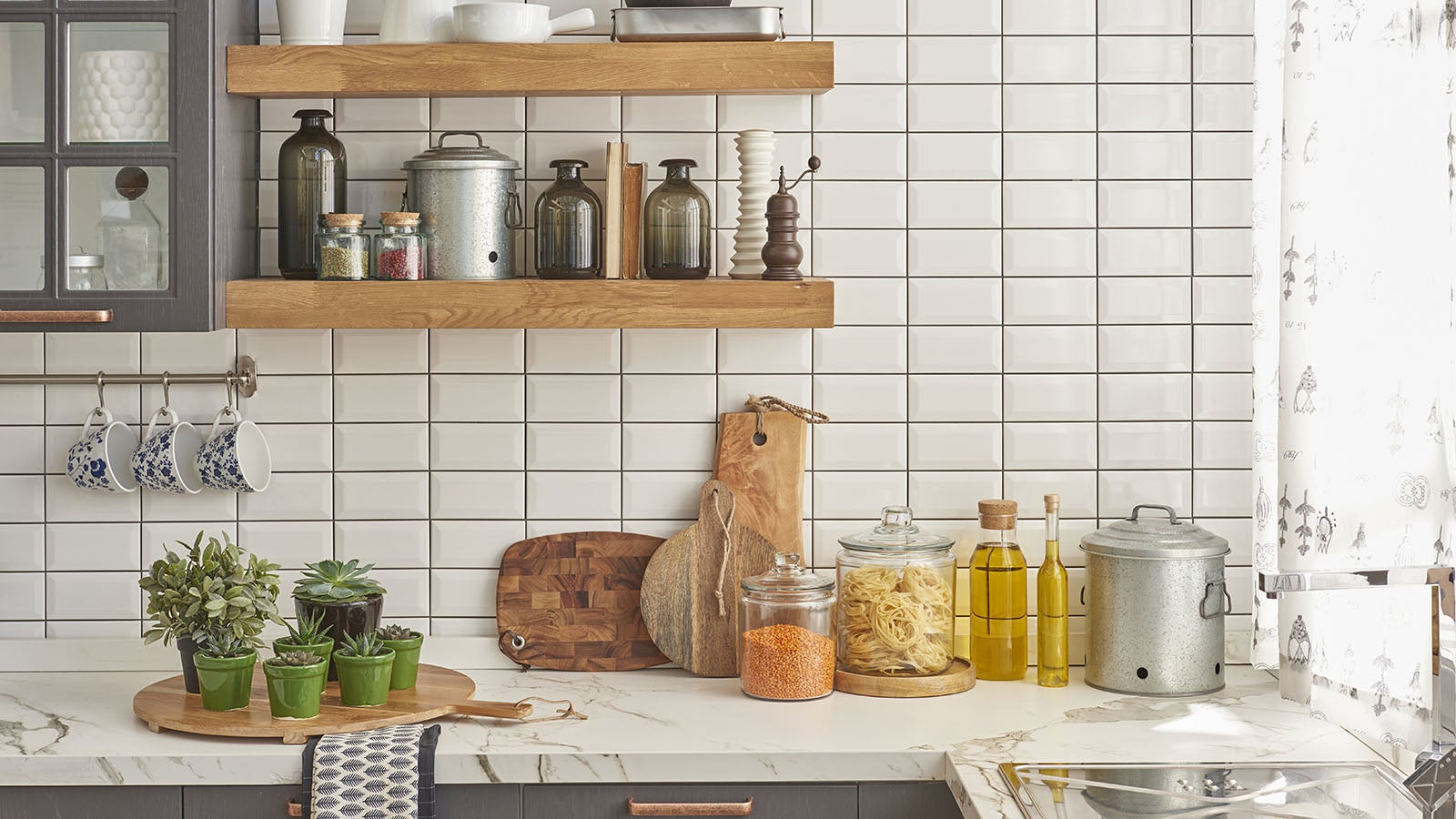 Beautiful white clean kitchen showing olive oil and full shelves