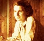 Sepia toned photograph head and shoulders of a smiling Rosalind Franklin