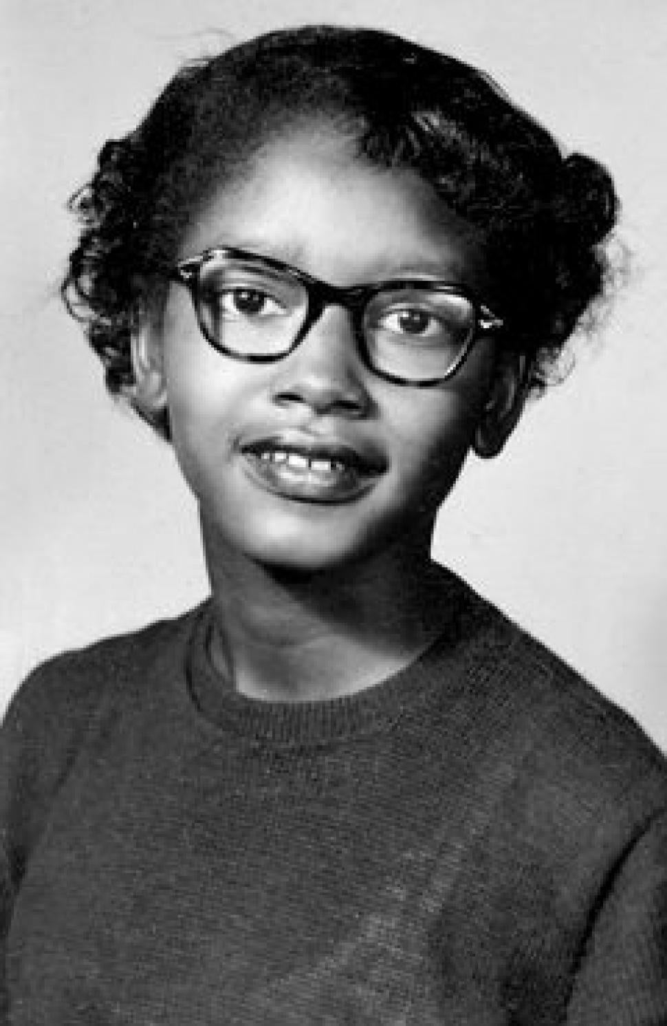 A black and white photograph of Claudette Colvin smiling