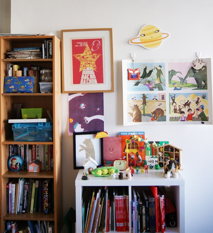 Artist's book collection and studio wall