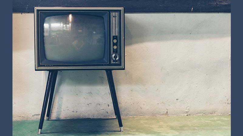 Old fashioned TV set with dials