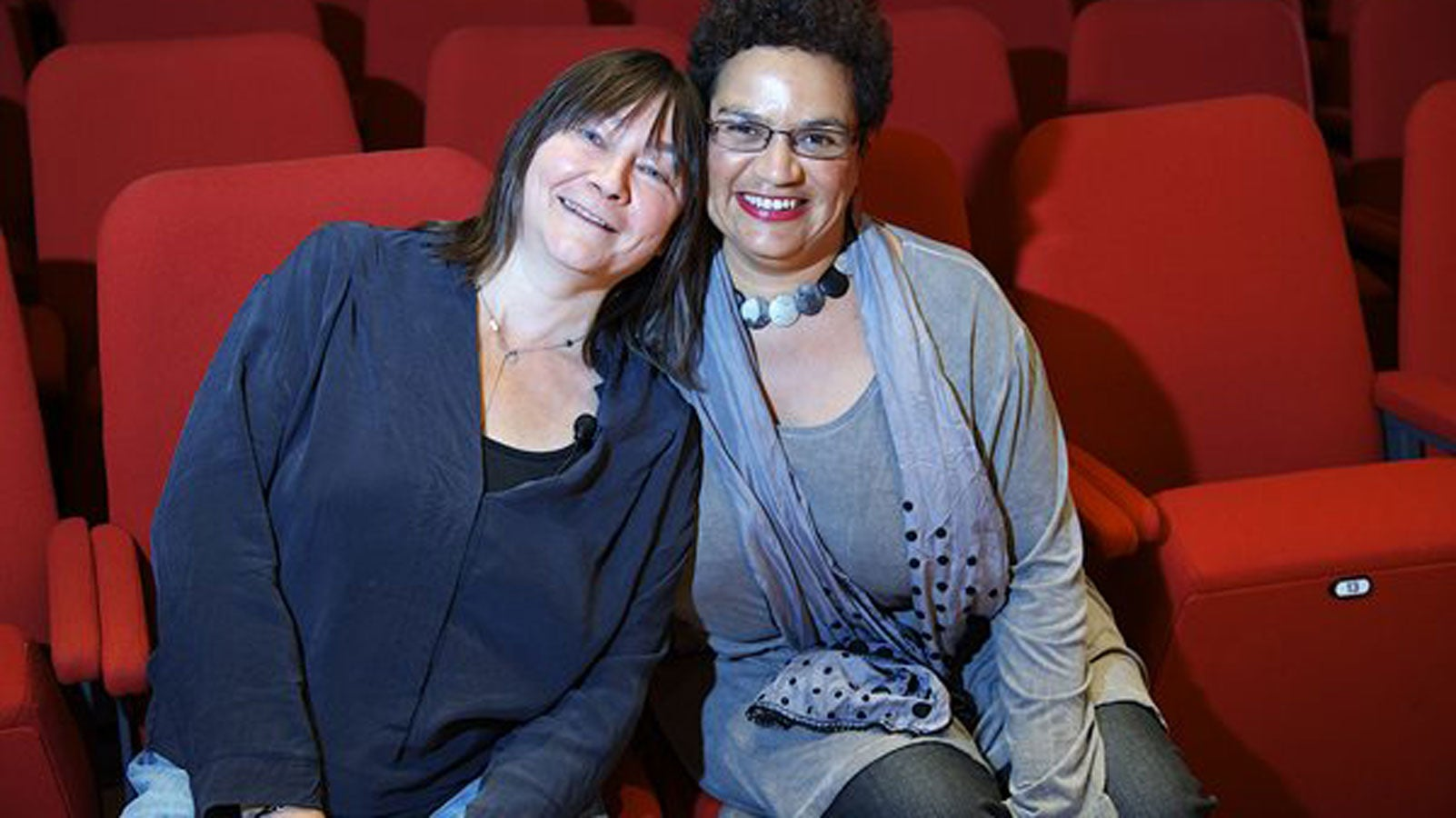 Ali Smith and Jackie Kay sitting next to eachother smiling
