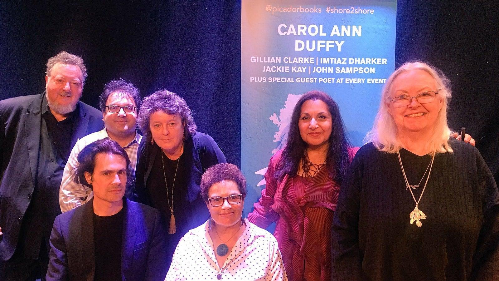 A group photo of Carol Ann Duffy, Gillian Clarke, Imtiaz Dharker, Jackie Kay and John Sampson