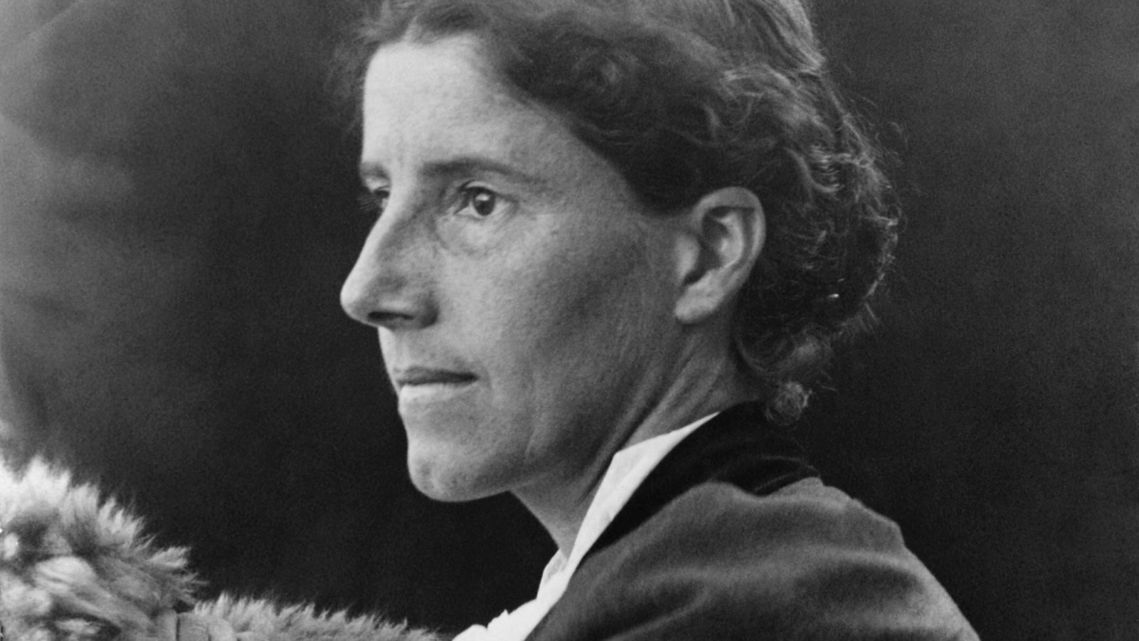 A black and white photograph of Charlotte Perkins Gilman taken in profile in roughly 1900