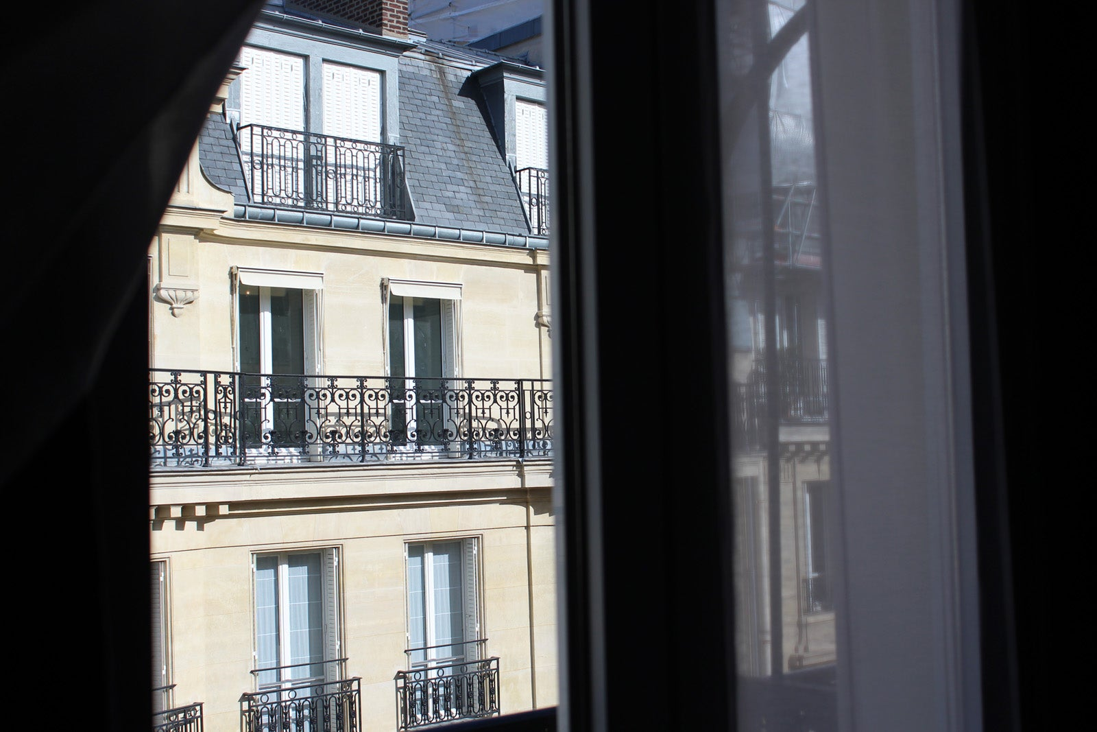 View of Paris out of an apartment window