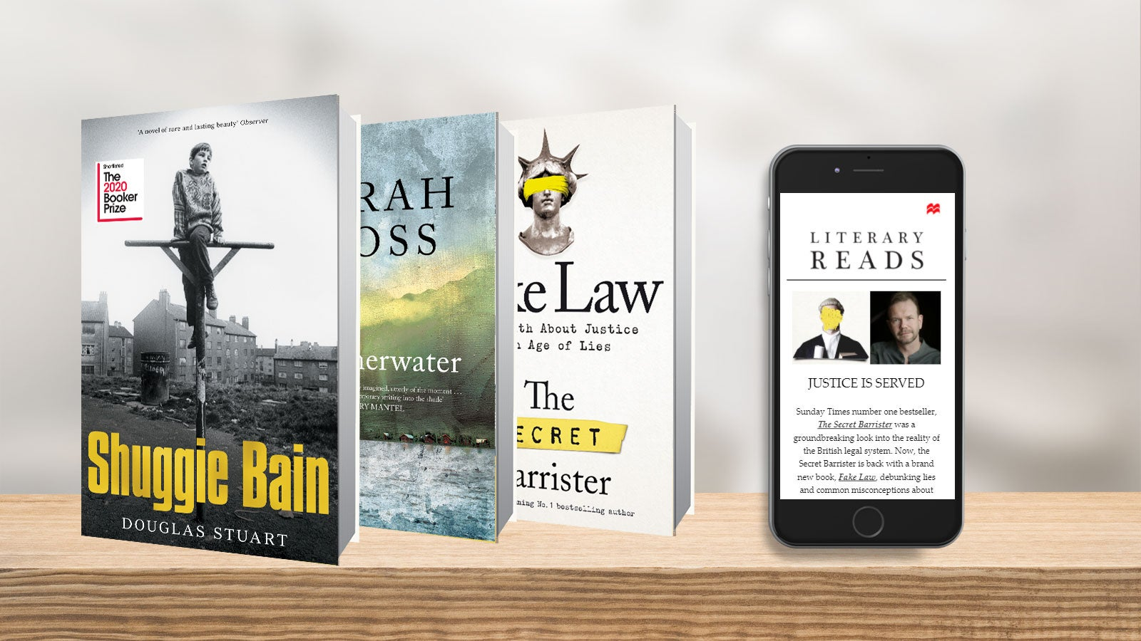 Shuggie Bain, Summerwater and Fake Law beside an iPhone displaying the Literary Reads newsletter.