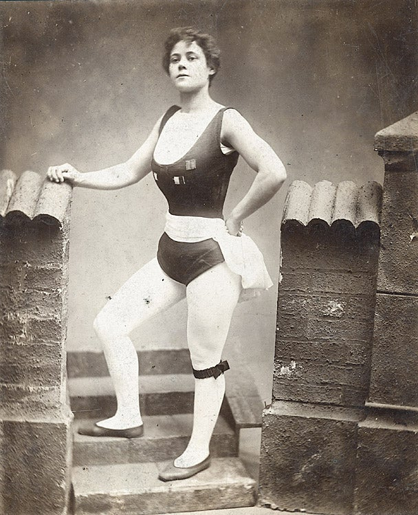 A black and white photograph of Miriam Kate Williams wearing white tights and a black leotard.
