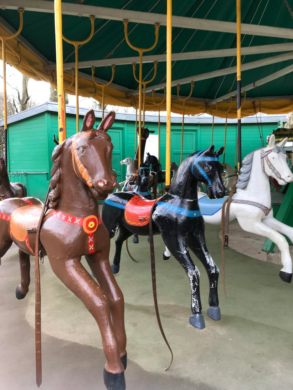 A close up of horses on the carousel
