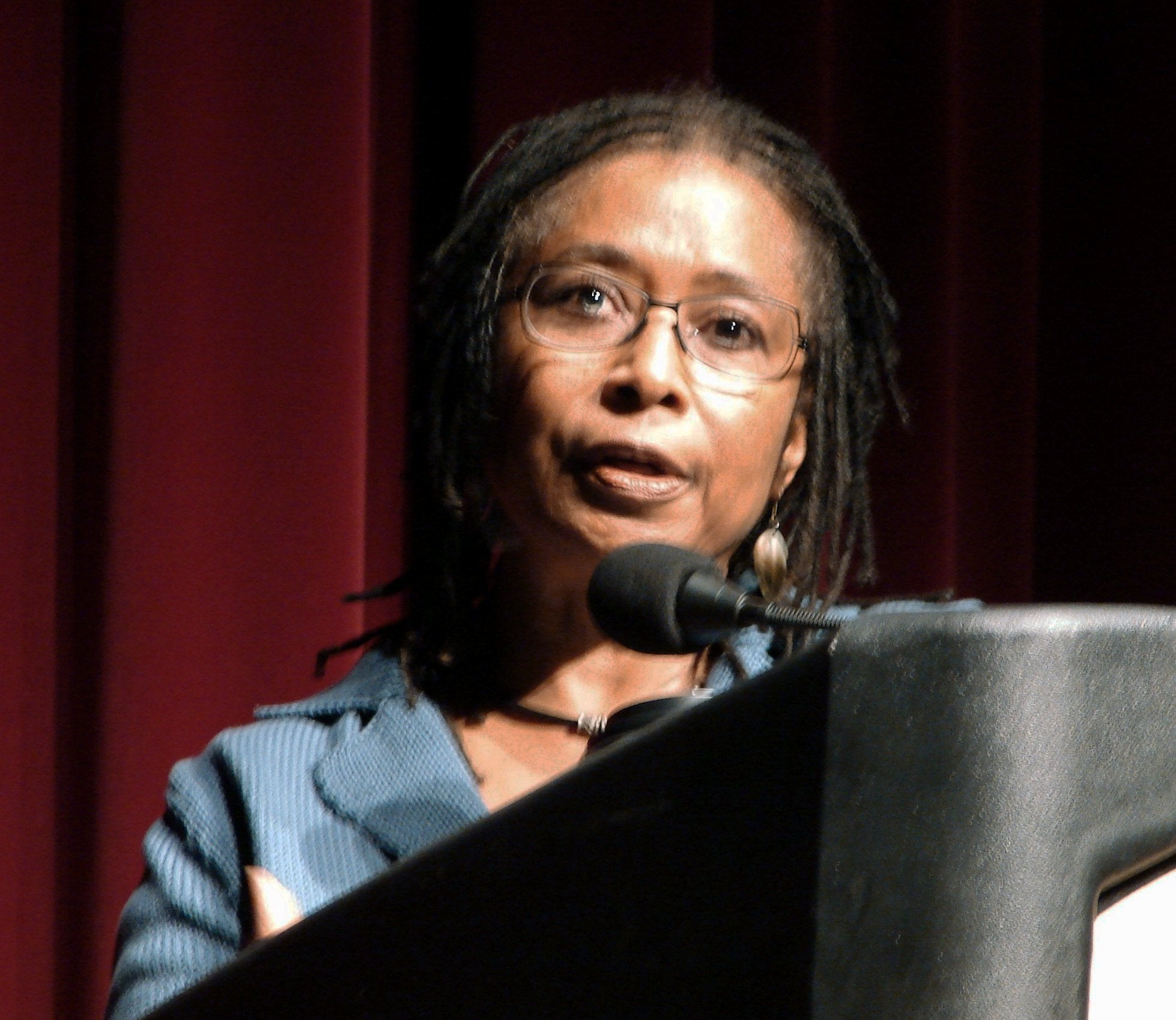 Photograph of Alice Walker making a speech at a lectern