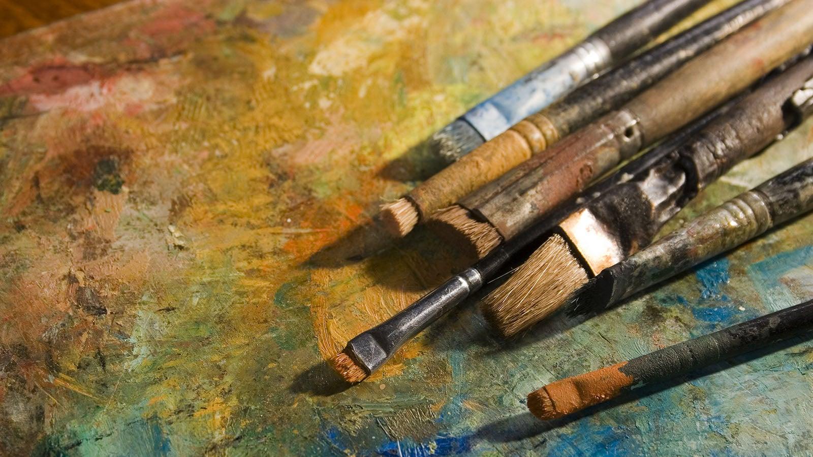 Paintbrushes on painting