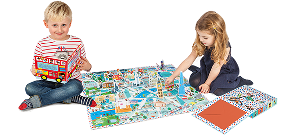 Two young children playing with a Campbell London map.