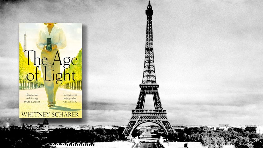 The Age of Light cover against a black and white photo of the Eiffel Tower