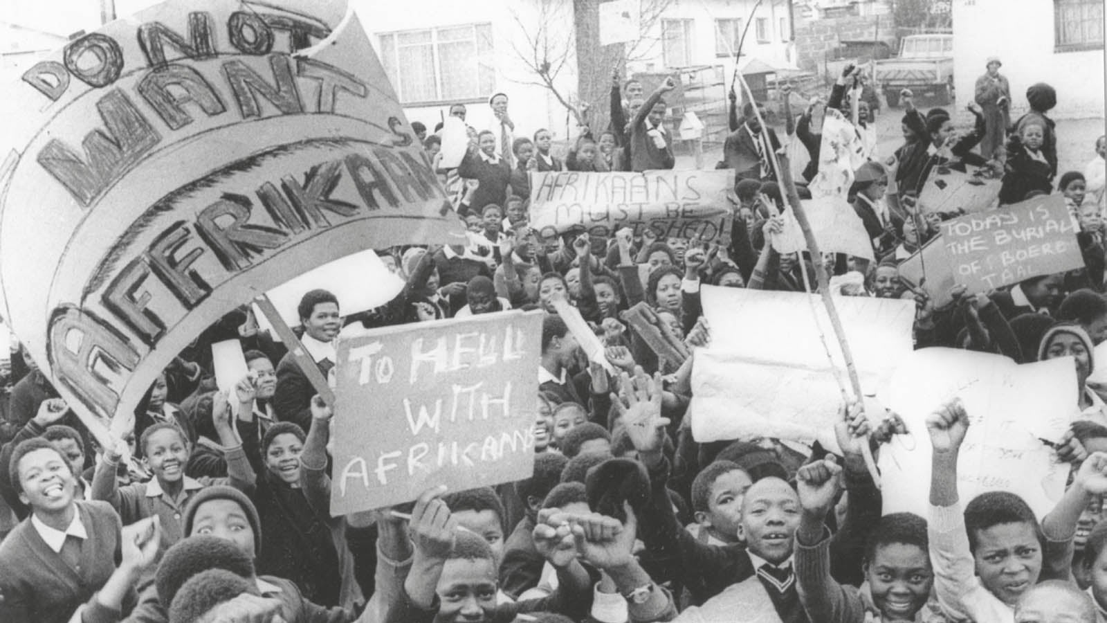 Peaceful young schoolchildren, smiling, singing, marching and displaying a clear message intended for the Department of Bantu Education authorities. This was before the violent intervention of the police.