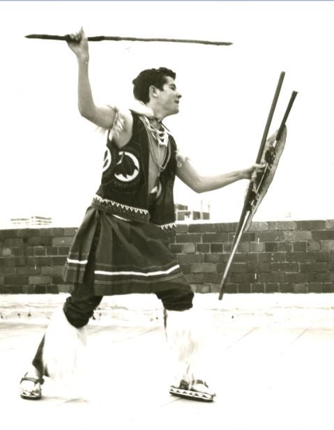 A young Johnny practising stick fighting on Charlie Mzila's apartment rooftop.JPG