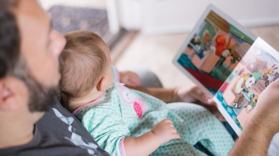 Image of male reading to a girl child