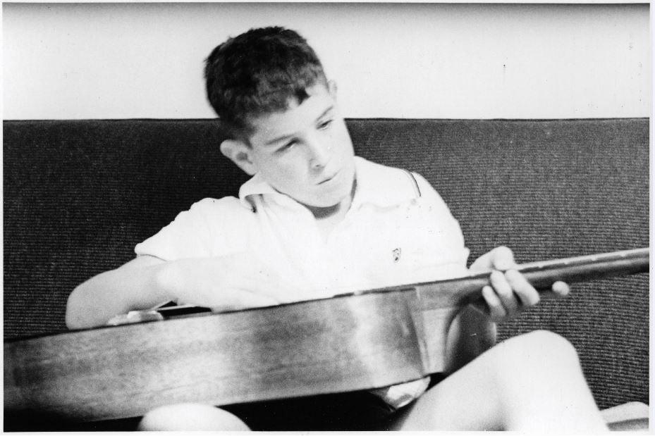 Johnny stringing his guitar.JPG