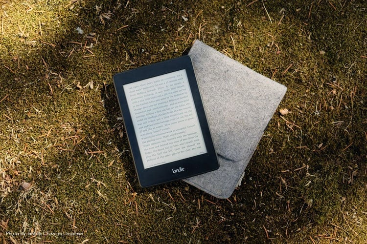 Photo of a Kindle laying on the grass