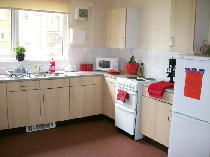 shared kitchen with red accessories