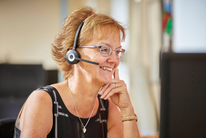 Customer services operative on a call