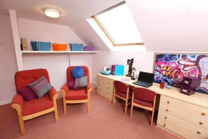Key workewr accommodation in Reading - a room with a desk and two chars plus shelving