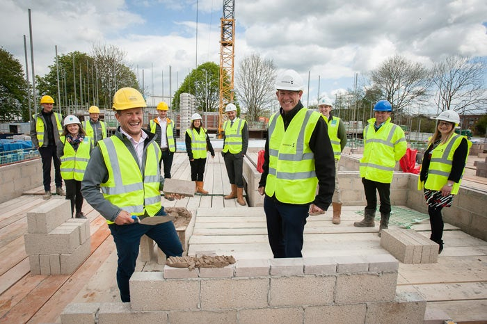 A team of people on the development site in Yate