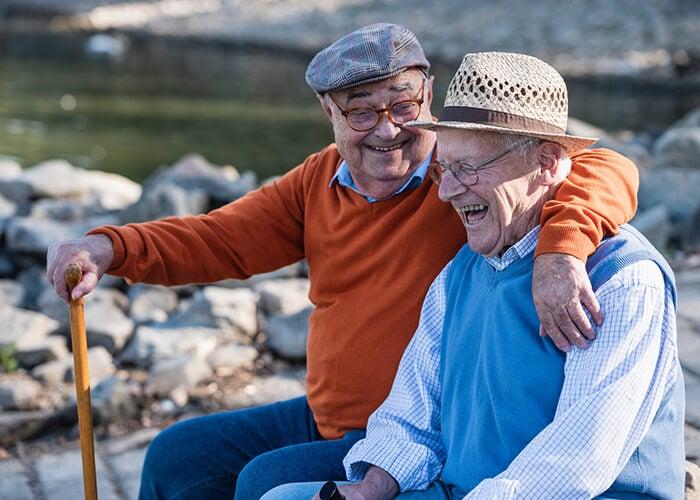 Two older men laughing