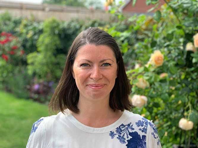 Heidi Leyshon, Communities Manager in a flower garden