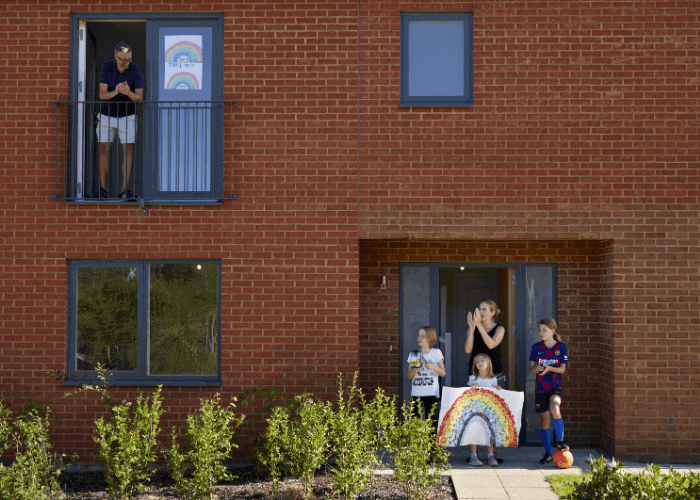 A family standing in front of their home for the clap for carers
