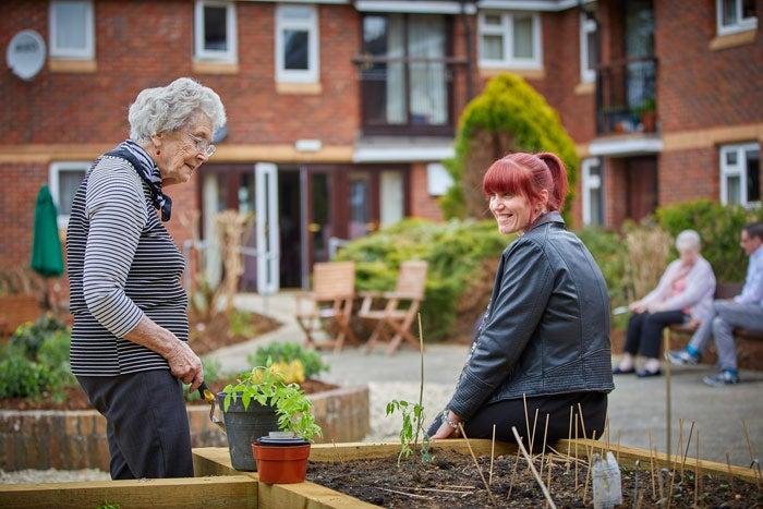 Two women in a community garden